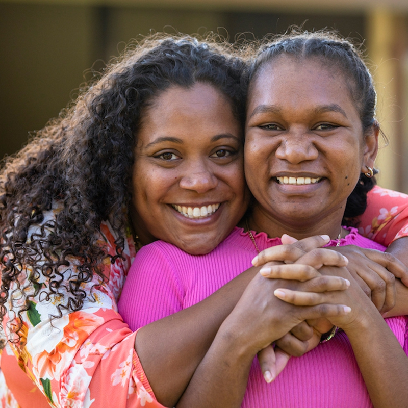 Black woman hugging her friend